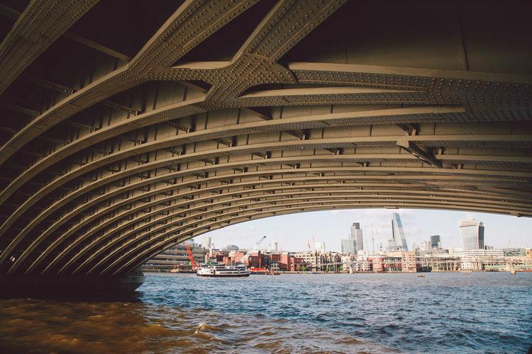 20 fenchurch london and 122 leadenhall street seen through arch bridge