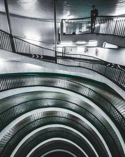 Spiral Wide Shot Photographer Photography Photo Parking Spiral Light Exploring Exploring Indoors  In A Row Ceiling Railing Architecture Built Structure No People Illuminated Parking Garage
