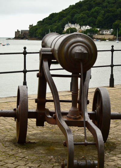 Canon at Bayards Cove, Dartmouth, aiming at Dartmouth Castle, on River Dart, Devon, England Bayard's Cove Bayards Canon; Castle Close-up Day Focus On Foreground Metallic No People Outdoors River Dart Sky Tranquil Scene Tranquility Wood - Material Wooden Post