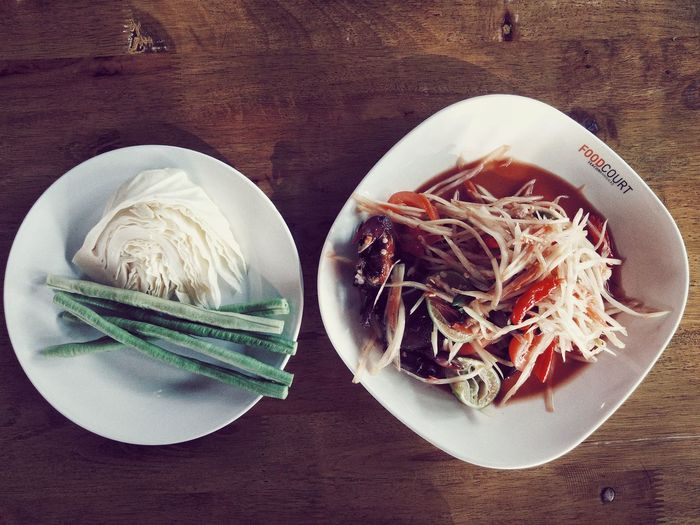 enjoy eating Papaya Salad Spicy Food Plate Table High Angle View Directly Above Close-up Food And Drink Serving Size Ready-to-eat
