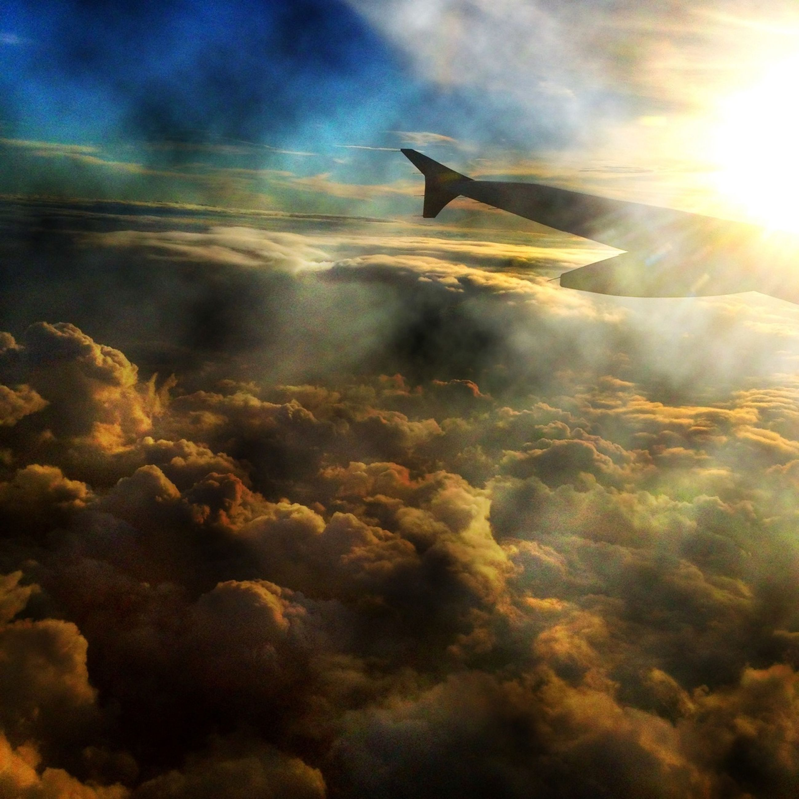 sky, airplane, cloud - sky, aircraft wing, flying, cloudscape, beauty in nature, air vehicle, scenics, aerial view, nature, sunset, cloud, sun, cloudy, tranquility, mode of transport, transportation, sunbeam, tranquil scene