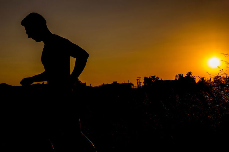 SUNSET RUNNER Athlete Before The Dawn Greek Olympics Sunset Silhouettes Beauty In Nature Black And Orange Exercising Fitness Training Good Looking Man Healthy Lifestyle Leisure Activity Lifestyles Men One Person Orange Color Physical Activity Real People Robust Runner Side View Silhouette Sport Sports Photography Sunset