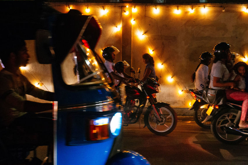 The streets were bustling and writhing with energy in Galle as Sri Lankans celebrated Vesak, the day of Buddah. Shooting from a Tuk Tuk in low light is extremely difficult in ever changing circumstances with light shifting every time traffic moves. Sri Lanka The Street Photographer - 2018 EyeEm Awards The Traveler - 2018 EyeEm Awards City Group Of People Illuminated Land Vehicle Medium Group Of People Mode Of Transportation Motor Vehicle Motorcycle Night Real People Rickshaw Road Transportation Travel