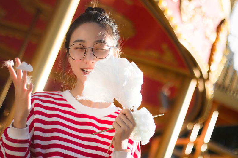 Casual Clothing Close-up Cute EyeEm Best Shots Happiness Leisure Activity Lifestyles Mashmallow Merry-Go-Round Horse Women Who Inspire You Portrait Real People Red Showcase March Smile Sunshine Theme Park