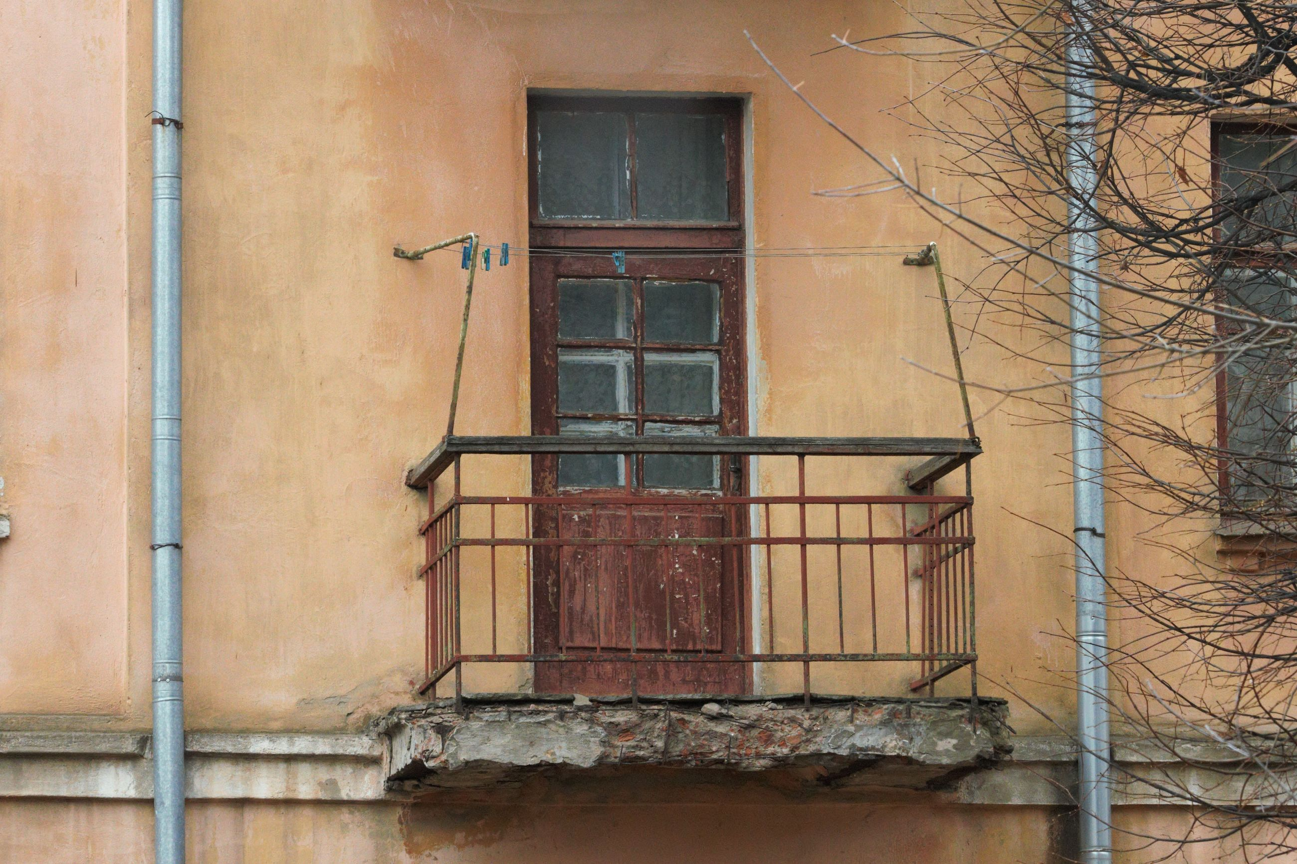 built structure, architecture, window, building exterior, building, no people, day, residential district, house, door, entrance, closed, wall - building feature, outdoors, old, glass - material, wall, low angle view, safety, bare tree