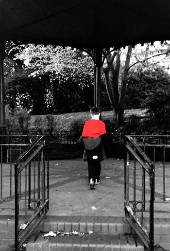 Red Jumper Bandstand Lone Boy People Watching Urban Park Scenic Autumn Backshot Childs Play