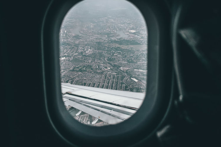 City seen through aircraft window