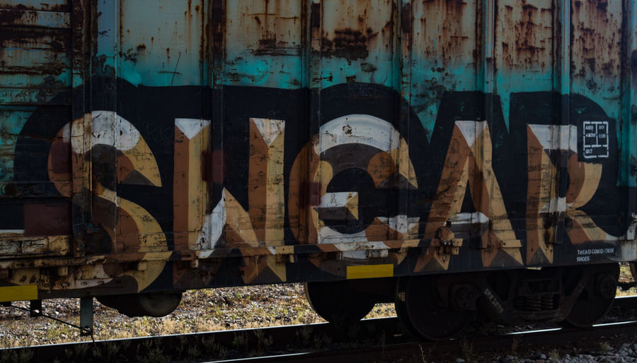 Graffiti on a railroad car on a siding in Irving, TX Close-up Dirty Graffiti Industry Railroad Rusty Street Art Swear Train Car