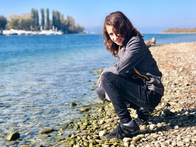 Daughter on the River Rhein EyeEm Selects Land One Person Water Beach Real People Nature Outdoors Casual Clothing Beauty In Nature First Eyeem Photo