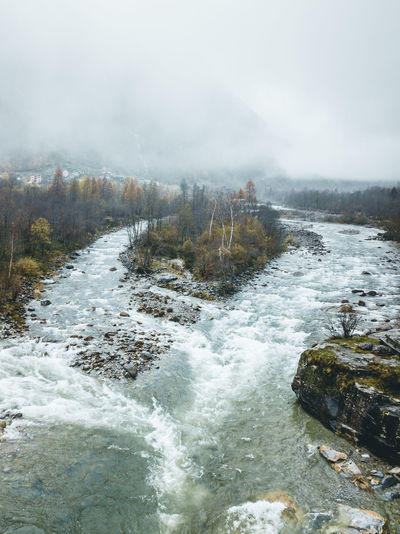 Random river in Switzerland Water Scenics - Nature Nature Motion Beauty In Nature No People Power In Nature Land Power Forest Environment Non-urban Scene River Rock Outdoors Flowing Water Flowing Waterfall Landscape Fog Foggy Mist Autumn Mountain Tree