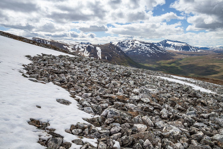 Hiking Northern Norway Norway Screen Beauty In Nature Cloud - Sky Cold Temperature Day Environment Landscape Mountain Mountain Range Nature No People Non-urban Scene Outdoors Rock Rock - Object Rocks Scenics - Nature Scree Field Sky Snow Snowcapped Mountain Solid Summit Tranquil Scene Tranquility