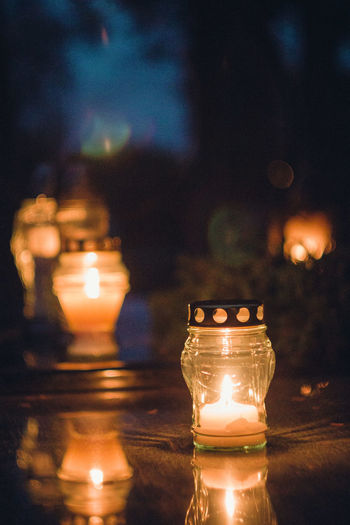 in the cementery Autumn Autumn Colors Lietuva Lithuania Close-up Electricity  Flame Focus On Foreground Glowing Illuminated Indoors  Light Bulb Lighting Equipment Nature Night No People Oil Lamp Sky Table Vintage Lens Water