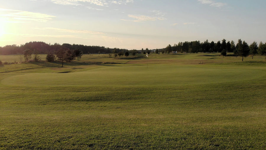 Behind the 8th green at Kuortane Golf Golf Green Golf Course Open Field Empty Summer Sunset Grass Environment Sport Nature Activity Green - Golf Course Outdoors No People Landscape Emptiness Manicured Lawn Lawn Contour Contours Trees Undulating