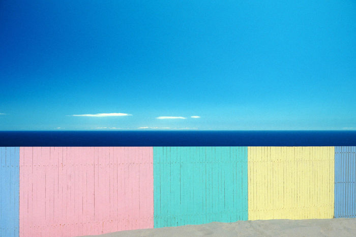 Architecture Beach Beach Fence Beach Hut Blue Building Exterior Built Structure Clear Sky Copy Space Day Horizon Horizon Over Water Multi Colored Nature No People Outdoors Pastellcolours Sky Sunlight Tranquility Wall - Building Feature