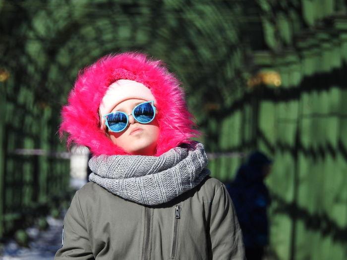 Teenage girl wearing fur coat