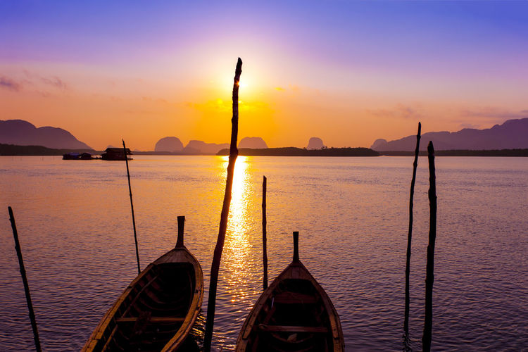 Traditional thai boats at sunrise beach. Andaman Andaman Sea Beauty In Nature Lake Longtailboat Nature Nautical Vessel Phuket Sky Sunset Taxiboat Thailand Tranquil Scene Tranquility Transportation Travel Destinations Water Watertaxi