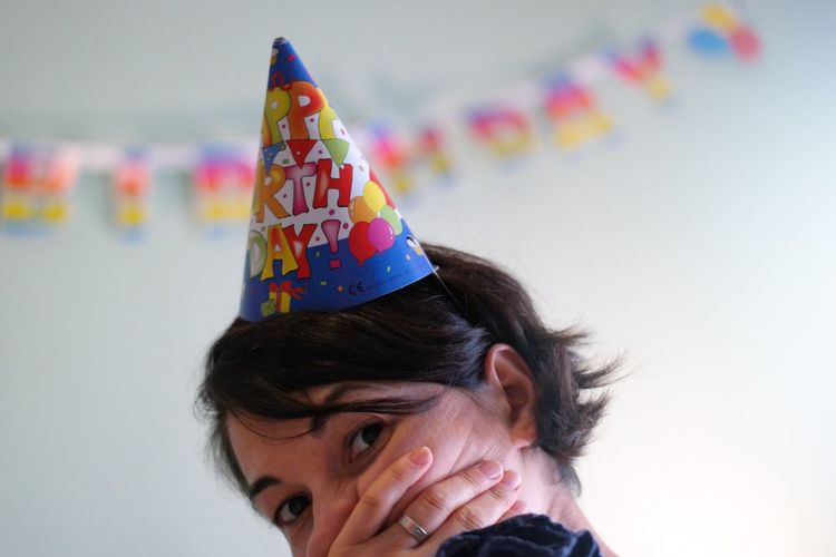 Close-Up Portrait Of Woman Wearing Hat In Party