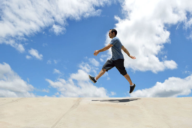 Young man walking in the air - levitating Adult Air Walking Flying Jump Levitating Levitation Man Model Motion Neutral Background One Man Only One Person People Young Adult Young Men