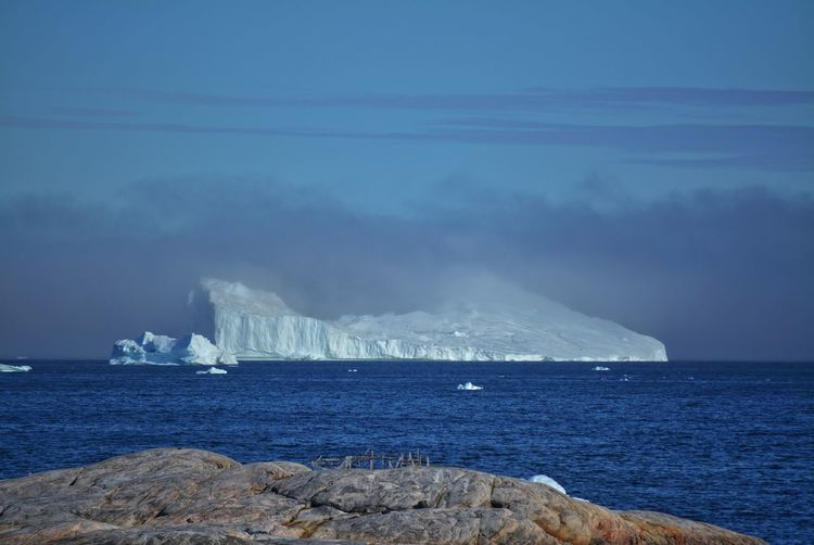 Ilulissat, Greenland, July | UNESCO world heritage site | impressions of Jakobshavn | Disko Bay Kangia Icefjord | huge icebergs in the blue sea on a sunny day | climate change - global warming Greenland Travel Destinations UNESCO World Heritage Site Iceberg Icebergs Ice Sea White Nature No People Day Scenics - Nature Outdoors Water Climate Change Global Warming Melting Glacier Idyllic Non-urban Scene Horizon Over Water Tranquil Scene Tranquility Horizon Beauty In Nature Cold Temperature