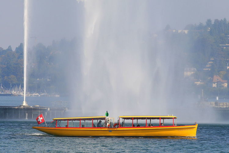Beauty In Nature Day Geneva Geneva Lake Lake Men Mode Of Transport Nature Nautical Vessel Outdoors People Real People Sailing Scenics Sky Switzerland Transportation Tree Water Water Jet Waterfront Wet Paint The Town Yellow