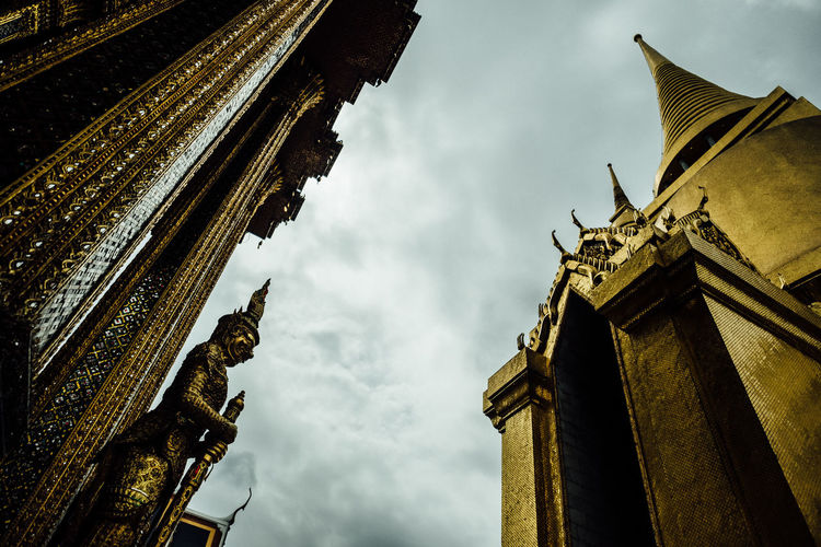 Grand Palace, Bangkok Bangkok Grand Palace Grand Palace Bangkok Thailand Animal Themes Architectural Column Architecture Building Exterior Built Structure City Cloud - Sky Day Gargoyle History Low Angle View No People Outdoors Sculpture Sky Statue Travel Destinations
