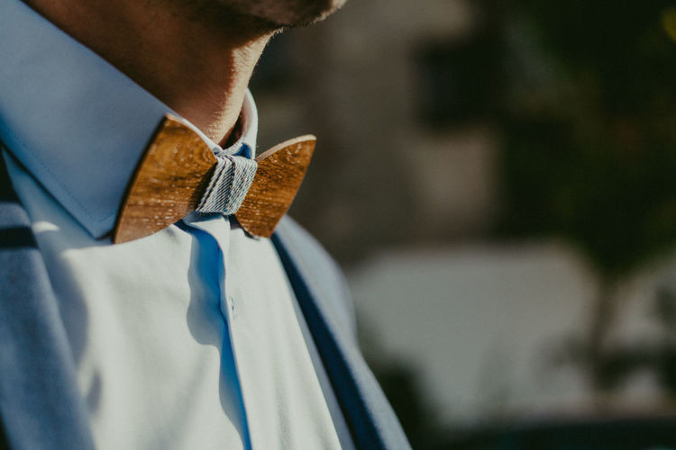 Close-Up Midsection Of Man Wearing Wooden Bow Tie