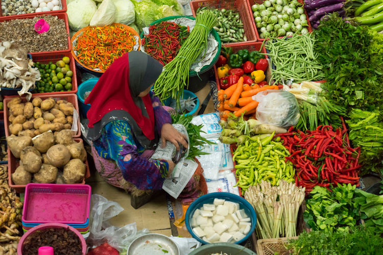 A woman selling various vegetables and local foods at Kota Bharu Main Market or famously known as Pasar Siti Khadijah in Kelantan State of Malaysia. Food And Drink Malaysia Truly Asia Market Pineapple Rural Tourist Attraction  Bargain Buyer Carrot Chilli Colorful Daily Life Fresh Fruit Kelantan Khadijah Organic Pasar Ringgit Malaysia Seller Siti Traditional Travel Destinations Vegetable Wet