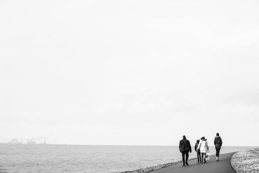 Winter Beauty In Nature Blackandwhite Dam Day Dike Horizon Over Water Minimalism Nature Ocean Outdoors Real People Scenics Sea Sea And Sky Seawall Togetherness Walking Wind