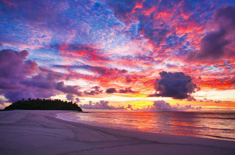 Paradise Beach at the Fiji Islands Fiji Fiji Islands Island Tropic Sky Beauty In Nature Cloud - Sky Scenics - Nature Tranquil Scene Tranquility Land Idyllic No People Nature Outdoors Sunset Sea Water Orange Color Beach Dramatic Sky Horizon Non-urban Scene Horizon Over Water