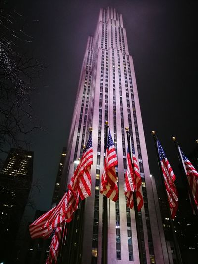 Rockefeller Center New York Rockefeller Center United States USA City Built Structure Flags City In The Night NYC Street Photography Architecture Building Exterior Skyscraper Flag Illuminated Night Patriotism