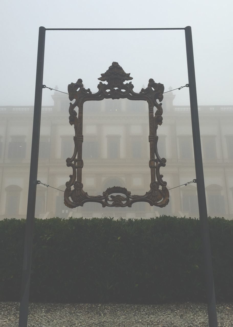 Building Seen Through Picture Frame During Foggy Weather