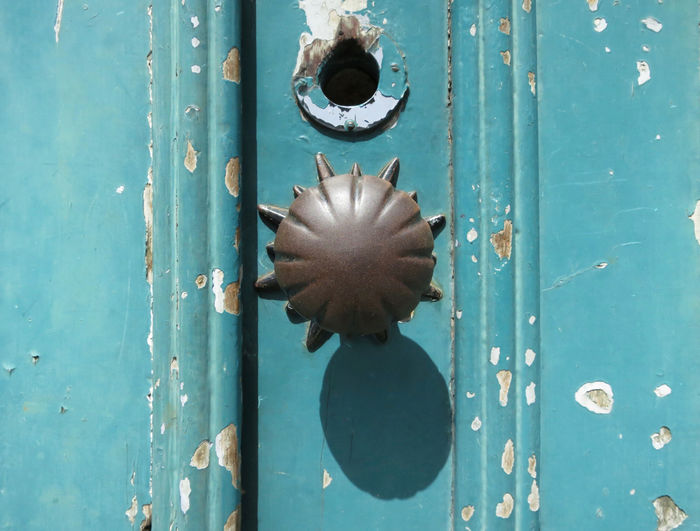 door knob on a turquoise door Backgrounds Blue Close-up Closed Day Door Doorknob Entrance Full Frame Keyhole Knob Lock Metal No People Outdoors Pattern Protection Safety Security Turquoise Colored Weathered Wood - Material