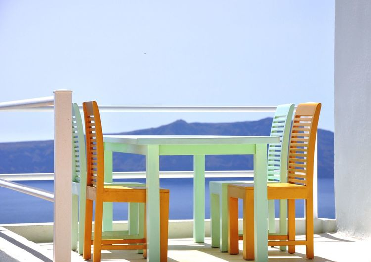 Table And Chairs Best Seat In The House Pastel Colors Pastel Colours Pastel Shades Balcony View Cliff Top View Outdoor Dining  Rooftop Terrace Santorini, Greece Mediterranean  Greece Greece Santorini Island