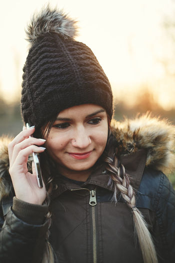 Woman Talking On Mobile Phone During Winter