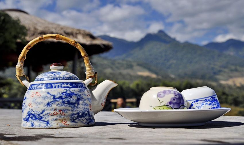 Tea pot set. Tea Pot Set Beauty In Nature Bowl Day Flower Focus On Foreground Mountain Mountain Range Nature No People Outdoors Scenics Sky Table Teapot