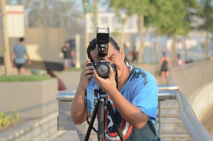 Photography Themes Camera - Photographic Equipment Photographing Focus On Foreground One Person Real People Technology Photographer Holding Photographic Equipment SLR Camera Digital Camera Lifestyles