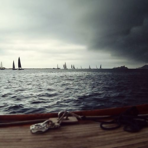 Close-up of boats in sea against sky