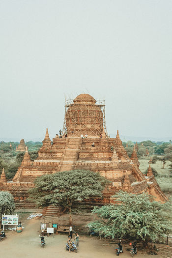 Ancient Civilization Architecture Backgrounds Bagan Beauty In Nature Building Exterior Built Structure Clear Sky Copy Space Day Group Of People History Nature Outdoors Place Of Worship Plant Real People Religion Sky The Past Tourism Travel Travel Destinations Tree Women