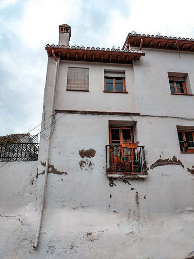 old houses in Granada Residential District Residential Building Old Town SPAIN Chimney Old House Granada, Spain Andalucía Whitewashed Window Sky Architecture Building Exterior Built Structure Cloud - Sky Deterioration Damaged Peeling Off Weathered