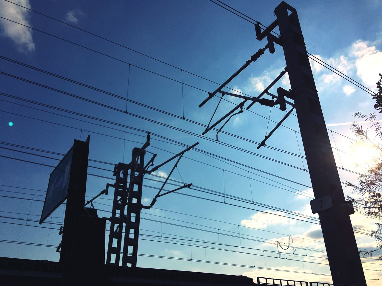 low angle view, cable, sky, electricity, power line, cloud - sky, power supply, connection, nature, silhouette, technology, no people, electricity pylon, fuel and power generation, architecture, built structure, outdoors, sunset, lighting equipment, day, complexity, telephone line