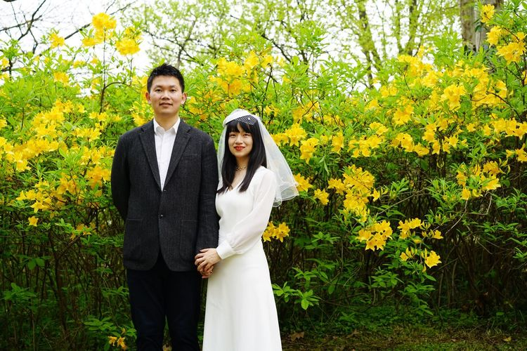 Bride And Groom Portrait Two People Togetherness Young Adult Plant Emotion Adult Couple - Relationship Front View Lifestyles Standing Looking At Camera Real People Married Wedding Flower