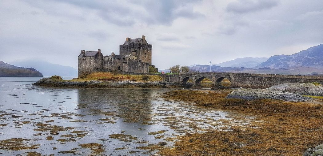 Eilean Donan Castle As one of the most iconic images of Scotland, Eilean Donan is recognised all around the world. Situated on an island at the point where three great sea lochs meet Malephotographerofthemonth Scotland Eilean Donan Castle Landscape_photography Water Sky Cloud - Sky Skyline Mountain Range