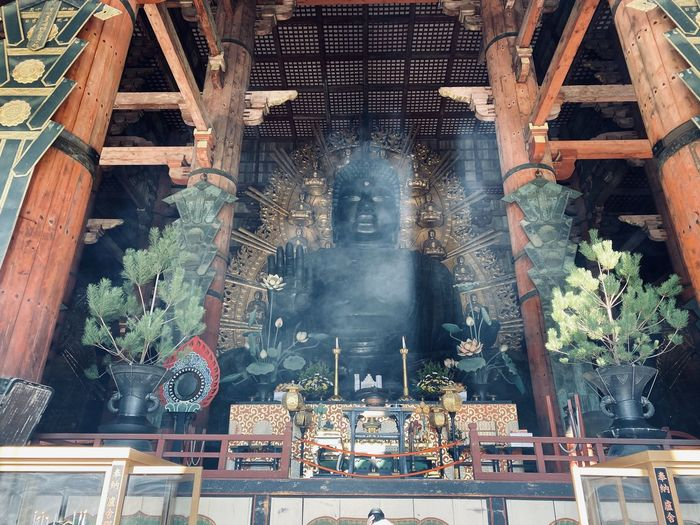Low angle view of buddha statue in temple
