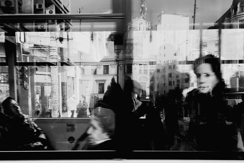 People in bus seen through windows
