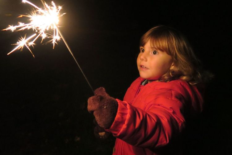 Scared Girl Holding Sparkler At Night