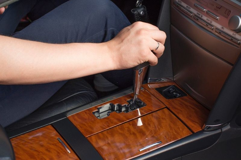 Young man's hand on gearshift Driver Vacation Gear Gearshift Stick Driving Leather Car Roadtrip Vehicle Interior Roadways Lifestyle Human Hand Hand Human Body Part One Person Indoors  Real People Lifestyles Transportation