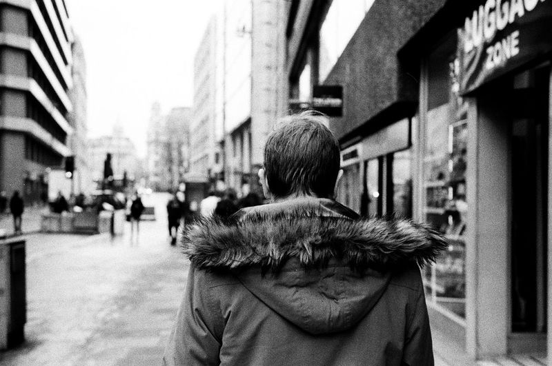 Rear View Of Man In City