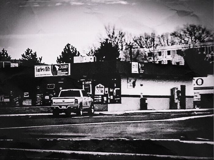Neighborhood store Placeofbusiness Built Structure Building Exterior Architecture Land Vehicle Day Sky Blackandwhite Photography Camerafilters IPhone7Plus Parking Area The Street Photographer The Street Photographer - 2017 EyeEm Awards