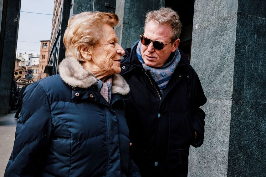 Wisdom and patience. Senior Adult Senior Men Two People Senior Women Jacket Outdoors Eyeglasses  Togetherness Real People Warm Clothing Day Leisure Activity Building Exterior Built Structure Men Lifestyles City Standing Senior Couple Architecture