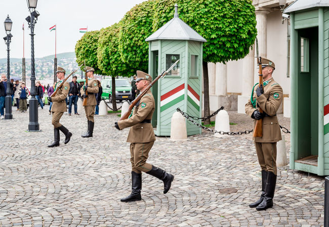 BUDAPEST, HUNGARY-17 april, 2014: Changing of the Guards in the Buda Castle, one of the Buda Castle attractions on april 17, 2014 Buda Castle Budapest Budapest, Hungary Government Guards Hungary National Soldiers Square Uniform Attractions Change Day Guard Change Honor Hungarian Marching Men Military Outdoors People Rifles Saluting Solders Traditional